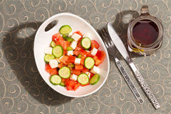 Healthy fresh feta salad with a mug of hot tea Royalty Free Stock Photography