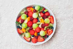 Free Healthy Fresh Fruit Salad In Bowl. Slices Of Strawberry, Raspberry, Kiwi, Tangerines, Blueberry On Plate. Delicious Fruits. Royalty Free Stock Image - 169799406