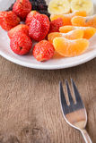 Healthy fresh fruits in a plate. Stock Photography