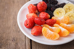 Healthy fresh fruits in a plate. Royalty Free Stock Images