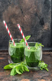Healthy fresh green spinach leaves smoothie. Detox concept Royalty Free Stock Images