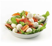 Healthy fresh rucola salad with mozarella and tomato slices Royalty Free Stock Photos