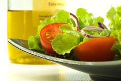 Healthy fresh salad on background with olive oil Stock Photo
