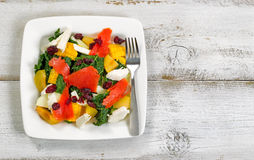 Healthy fresh salad and fish on plate with rustic white wooden b Royalty Free Stock Image