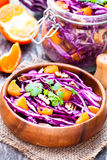 Healthy fresh salad with red cabbage and oranges with walnuts i stock photo