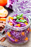 Healthy fresh salad with red cabbage and oranges with walnuts i royalty free stock photos