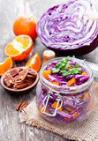 Healthy fresh salad with red cabbage and oranges with walnuts i stock image