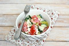 Healthy fresh salad from vegetable, tomatoes, cucumber, green pepper, cottage cheese, chives and olive oil Royalty Free Stock Photography
