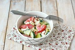 Healthy fresh salad from vegetable, tomatoes, cucumber, green pepper, cottage cheese, chives and olive oil Royalty Free Stock Images