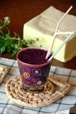 Healthy fresh smoothie with blueberry and papaya fruits. Fresh healthy blueberry and papaya smoothie on a glass decorated on a wooden table Royalty Free Stock Photo