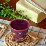 Healthy fresh smoothie with blueberry and papaya fruits. Fresh healthy blueberry and papaya smoothie on a glass decorated on a wooden table Royalty Free Stock Photos