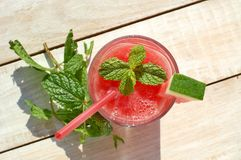 Healthy fresh smoothie drink from red watermelon, lime, mint and ice drift Stock Photography