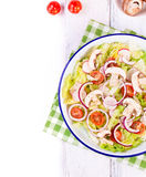 Healthy fresh summer salad with letucce, radish, cherry tomatoes, red onion and champignons with italian herbs Stock Images