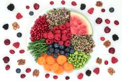 Healthy Fresh Superfood. Healthy fresh food with berry fruit, quinoa salad, sprouting seeds, melon, samphire, carrots and walnuts. Super foods high in royalty free stock photos
