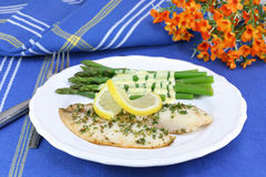 Healthy fresh tilapia fillets and asparagus. Stock Photo