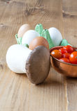 Healthy Fresh tomatoes cherryes with eggs, mushrooms and vegetab Royalty Free Stock Images
