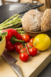 Healthy fresh vegetables and wholegrain rolls Stock Images