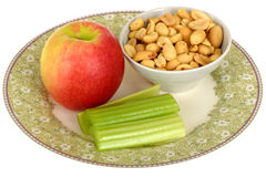 Healthy Fresh Vegetarian Ripe Juicy Apple with Celery and Peanuts Royalty Free Stock Images
