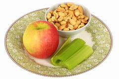 Healthy Fresh Vegetarian Ripe Juicy Apple with Celery and Peanuts Royalty Free Stock Image