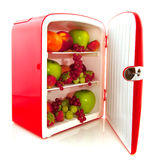 Healthy fridge for diet. Healthy American red fridge filled with fruit for diet Royalty Free Stock Photo
