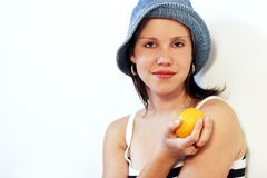 Healthy fruit 2. A beautiful young woman with an orange in her hand Stock Images