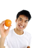 Healthy fruit. Asian young man showing a healthy fruit Royalty Free Stock Photography