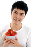 Healthy fruit. Asian young man showing a healthy fruit Stock Photo