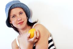 Healthy fruit. A beautiful young woman with an orange in her hand Royalty Free Stock Photography