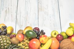 Still life fruits on wooden background. Healthy fruit background ; Studio photo of different fruits on white and  blue  vintage wooden table , high resolution Stock Images