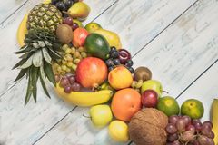 Still life fruits on wooden background. Healthy fruit background ; Studio photo of different fruits on white and  blue  vintage wooden table , high resolution Stock Photos