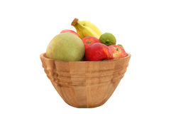 Healthy fruit bowl. Wooden bowl with fruit isolated on white Stock Photos