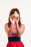 Healthy fruit, funny woman holding kiwi and lemon fruit for her e Stock Photos
