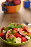 Healthy fruit mix salad on the kitchen  table Royalty Free Stock Photography