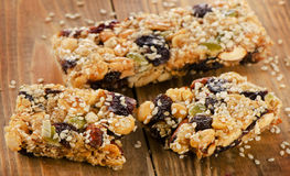 Healthy fruit and nut granola bars on a wooden table. Royalty Free Stock Image