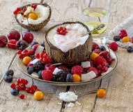 Healthy fruit salad. Coconut half with yogurt and healthy fruit salad Stock Photo