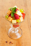 Healthy Fruit Salad on Wood Table Stock Photo