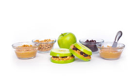 Healthy Fruit Sandwich with Ingredients. Healthy Granny Smith apple sandwiches with peanut butter, granola and raisins stock images