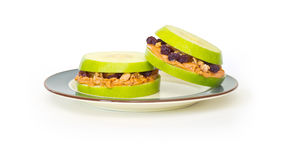 Healthy Fruit Sandwiches. Healthy Granny Smith apple sandwiches with peanut butter, granola and raisins Stock Photos