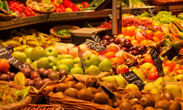 Healthy fruit stand. Fresh nicely arranged fruit stand with focus on oranges and apples Royalty Free Stock Images