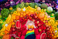 Healthy fruit and vegetable nutrition for kids. Little boy with variety of fruit and vegetable. Colorful rainbow of raw fresh fruits and vegetables. Child eating Stock Images