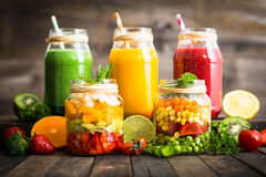 Healthy fruit and vegetable salad and smoothies royalty free stock images