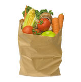 Healthy fruit and vegetables in a brown paper bag, isolated on a Stock Image