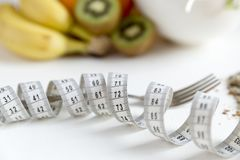 Healthy fruit,vegetables and measuring tape around the fork. Weight loss and right nutrition concept.  stock image