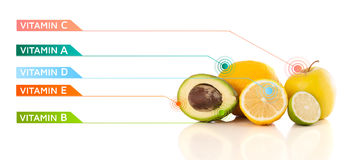Healthy fruits with colorful vitamin symbols and icons Stock Image