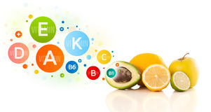 Healthy fruits with colorful vitamin symbols and icons Stock Images