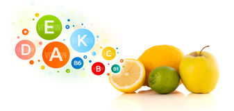 Healthy fruits with colorful vitamin symbols and icons Royalty Free Stock Image