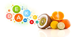 Healthy fruits with colorful vitamin symbols Stock Photo