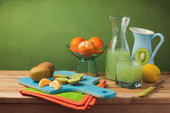 Healthy fruits and juice on wooden table Stock Image