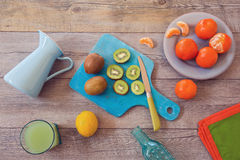 Healthy fruits and juice on wooden table. View from above Royalty Free Stock Photo