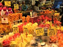 Healthy fruits, juices and colours in Boqueria Market, Barcelona, Spain. Food, nourishment, healthy lifestyle and beautiful details in a touristic location and royalty free stock image